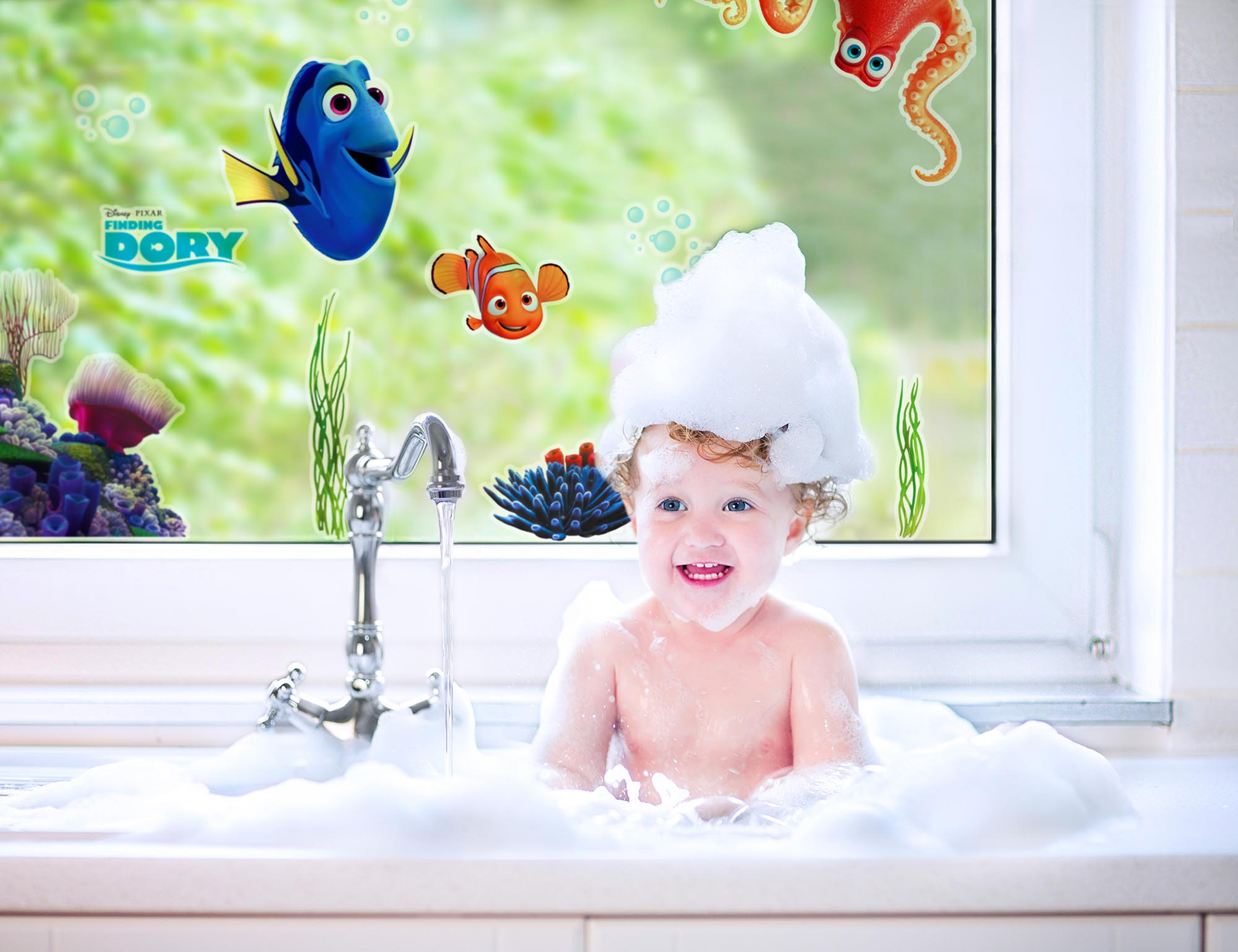 laughing baby girl in kitchen sink full water and foam